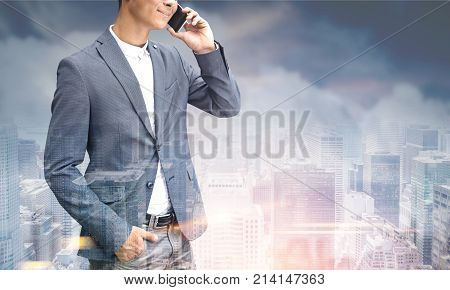 Unrecognizable Man On Phone, Gray City