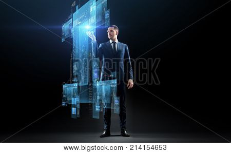 business, augmented reality, people and future technology concept - businessman in suit working with virtual screens projection over black background