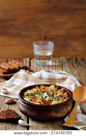 Cabbage minced beef ragu on a wood background