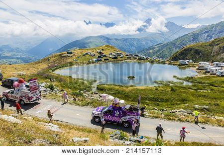 Col de la Croix de Fer France - 25 July 2015: Haribo caravan driving on the road to the Col de la Croix de Fer in Alps during the stage 20 of Le Tour de France 2015. Haribo is the biggest manufacturer of gummy and jelly sweets in the world.