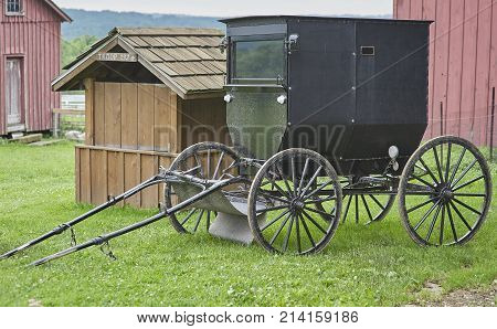 amish buggy parked in barnyard of Amish Farm