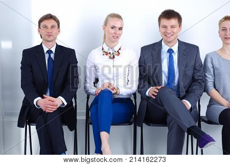 Group of business people sitting on chair in office . Group of business people.