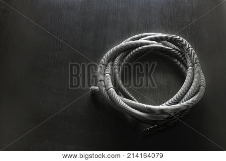 Vacuum Cleaner Hose on a Black Background