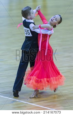 Minsk Belarus -October 28 2017: Professional Dance Couple Perform Juvenile-1 Standard European Program on the WDSF International WR Dance Cup in October 28 2017 in Minsk Republic of Belarus.