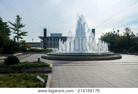 Fountain by Amalienborg palace in the city of Copenhagen in Denmark