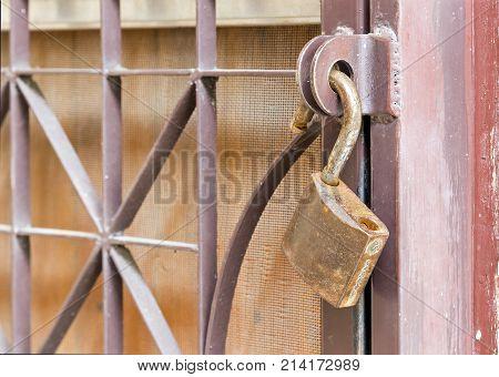 Brass Padlock Hook On Door Loop - Unlocked