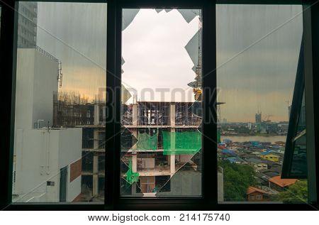 Broken window glass in building and sky