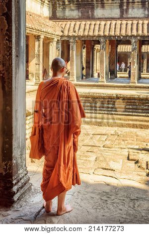 Buddhist Monk Exploring Courtyards Of Angkor Wat In Cambodia