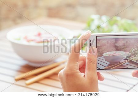 Taking A Picture Of Pho Bo In Street Cafe In Vietnam