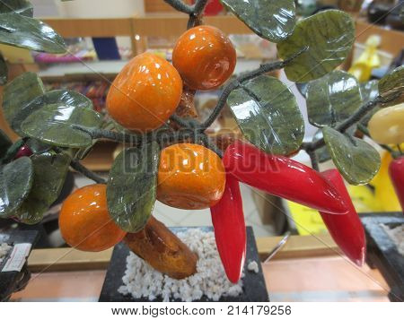 Beautiful jade tree with green leaves and orange tangerines in the store.