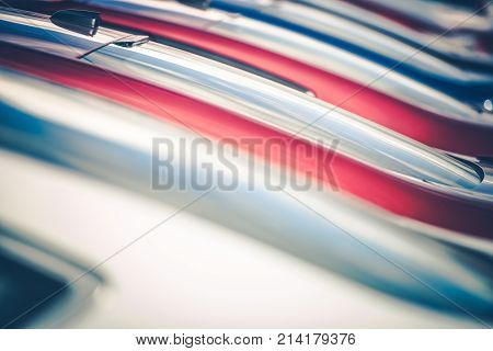 Brand New Cars in Stock. Cars and Transportation Industry Concept Photo. Factory Stock.