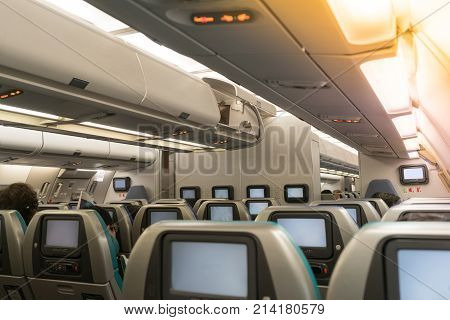 Beautiful Air Hostess Or Fight Attendant Waiting For Service Passengers On Board In Interior Aircraf