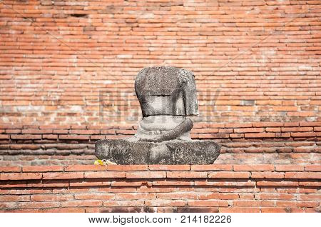 Damaged Buddha statue in the grounds of Wat Mahathat Ayutthaya Thailand