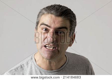 portrait of 40s to 50s white angry and upset guy and crazy furious and aggressive face expression nagging and complaining isolated on grey background in emotions and feelings concept poster