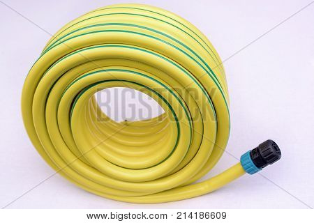 Yellow hose pipe on a white background