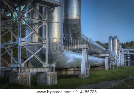 Industrial zone. The equipment of oil refining. Close-up of industrial pipelines of an oil-refinery plant