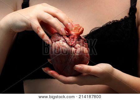 Real Human Heart In Beautiful Female Hands. Symbol Of Love, Pain. Insidious Nude Girl In A Bra Black