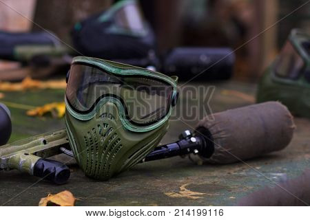 Paintball Equipment Placed On Wooden Background. mask