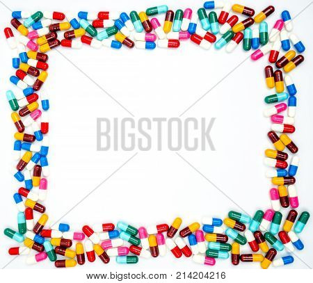 Colorful of antibiotics capsule pills on white background with copy space. Drug resistance concept. Antibiotics drug use with reasonable and global healthcare concept. Background for text