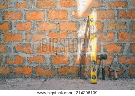 Mason Bricklaying Background With Level, Hammer And Clay Brick Blocks