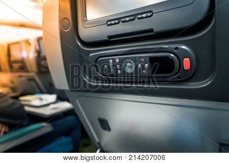 Close-up Lcd Monitor Screen Rear Seat On The Plane Technology For Entertainment. Airplane Seats With