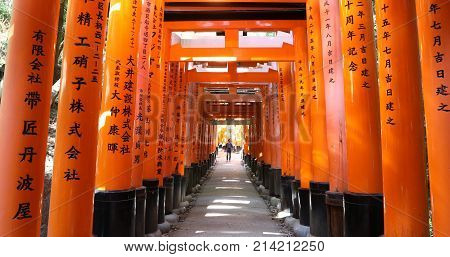 Kyoto, Japan - April 28, 2017: red torii gates of famous landmark Fushimi Inari shrine, south of Kyoto, Japan. Travel asia concept. Kyoto's popular Japan landmark.