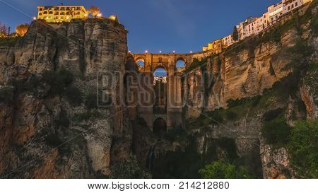 Day and dusk to night   of the popular historic landmark of spectacular Puente Nuevo, New Bridge at sunset, over Guadalevin River in Ronda town, Andalusia, Spain.