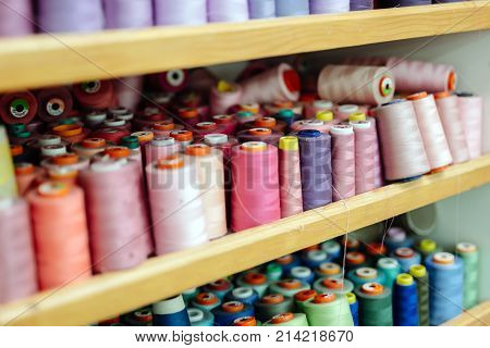 Colorful thread spools in modern fabric industry