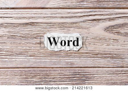 Word of the word on paper. concept. Words of Word on a wooden background.