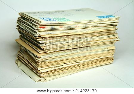 Pile of old letters in post envelopes, as a symbol of memoirs and time