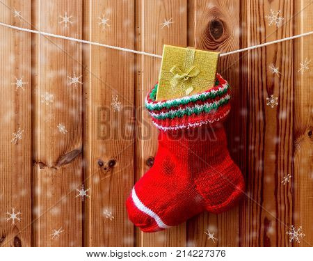 Red christmas stocking hanging on wooden wall