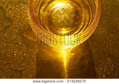 Golden texture with water drops. Thirst and its quenching