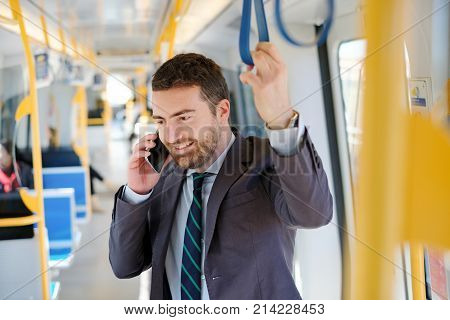 Businessman Commuter Is Traveling And Is Talking On The Mobile P