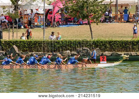 Rome Italy - July 30 2016: Dragon boat crews compete at the european championships held in Italy in 2016 summer in the photo the Italian crew