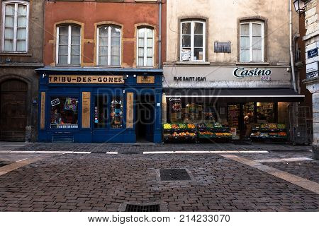 Lyon France--November 6 2017--Shops around a cobblestone square in the Old City section of Lyon. Editorial Use Only.