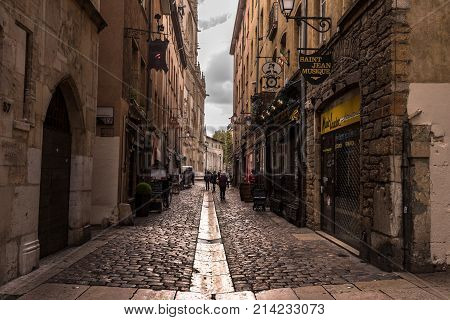Lyon France--November 6 2017--Shops and Restaurants around a narrow street in the Old City section of Lyon. Editorial Use Only.