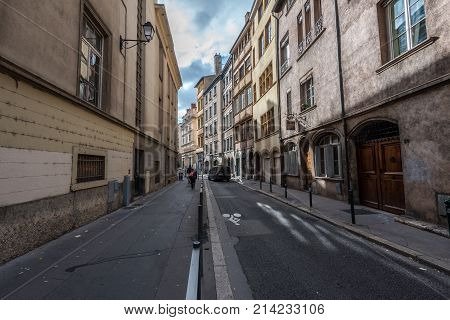 Lyon France -- November 6 2017 -- A long narrow side street in the old city section of Lyon. Editorial Use Only.