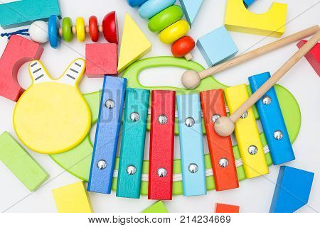 Xylophone and other wooden toys on a white background. flat lay