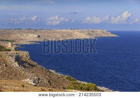 The most beautiful coasts of Italy, adriatic sea of Salento in  Apulia. The Otranto-Santa Maria di Leuca Coast and Tricase Woods regional nature on background Sant'Emiliano and Minervino watchtowers.
