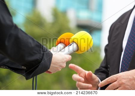 Female journalist conducting media interview with business person or politician