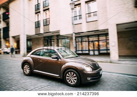 Vilnius, Lithuania - September 29, 2017: Side View Of Brown Volkswagen New Beetle Hatchback Coupe Car In Motion On Street.