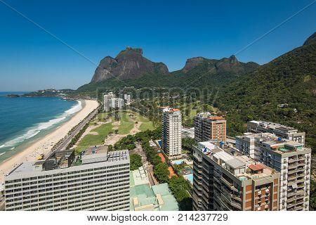 View of Sao Conrado Neighborhood and Beach with Pedra da Gavea Mountain in the Horizon, in Rio de Janeiro, Brazil