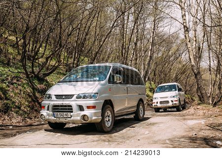 Stepantsminda Gergeti, Georgia - May 23, 2016: Mitsubishi Delica Space Gear on country road in spring mountains landscape. Delica is a range of trucks and multi-purpose vehicles produced by Mitsubishi Motors.