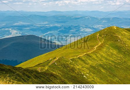 Footpath Through Mountain Ridge With Grassy Slopes