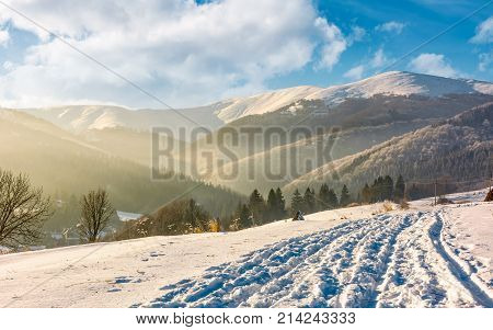 Snowy Mountain Ridge Above The Rural Area