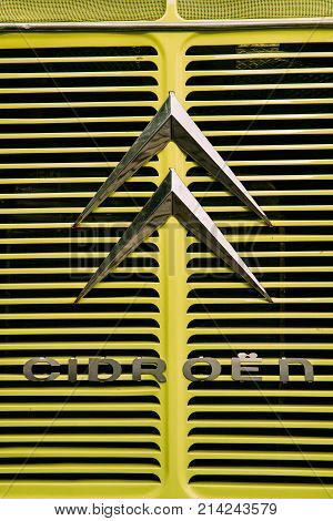 Prague, Czech Republic - September 23, 2017: Close View Of Old Logo Logotype Sign Of Citroen On Hood Of Old Retro Vintage Yellow Car.