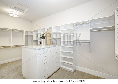 Huge Walk-in Closet With Shelves, Drawers And Clothes Rails