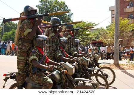 Soldiers on motorcycles at a military parade in Ouagadougou, Burkina Faso