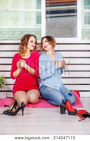 Two Young Friends Met And Drink Tea. The Concept Of Lifestyle An