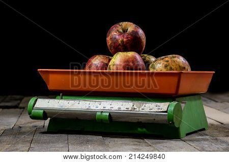 Tasty Apples And Old Kitchen Scales On A Wooden Table. Kitchen Scale With Scale.